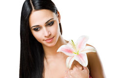 Romantic brunette beauty with flower. Royalty Free Stock Image
