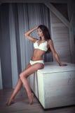 Romantic brunette girl in lingerie. Royalty Free Stock Image