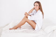 Romantic brunette woman in bed Stock Photography