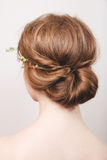 Romantic bun. Rear view of the head of a young redhead woman with a bun stock images