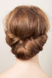 Romantic bun. Rear view of the head of a young redhead woman with a bun royalty free stock photos