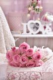 Bunch of pink roses lying on the bed Stock Photography