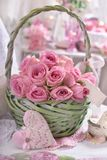 Romantic bunch of pink roses in wicker basket Stock Image