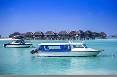 Romantic bungalo and travel boat Royalty Free Stock Images