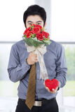 Romantic Businessman with Bouquet and Gift Box Stock Photo