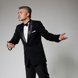 Romantic businessman in elegant suit dancing with Royalty Free Stock Photography