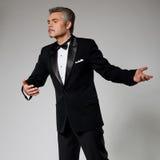 Romantic businessman in elegant suit dancing with Stock Photo