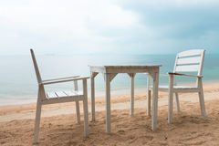 Romantic cafe with white table and chairs on the sea shore Royalty Free Stock Photos