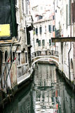 Romantic canal in venice. Street of water below romantic bridge in venice Stock Photography