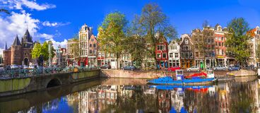 Romantic canalas of Amsterdam. Travel in Holland royalty free stock photo
