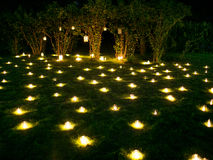 Romantic candle decoration on the summer grass Royalty Free Stock Image
