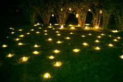 Romantic candle decoration on the summer grass Stock Photo
