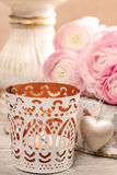 Romantic candle holder and bouquet of pink ranunculus flowers Royalty Free Stock Photo