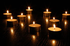 Romantic candle light. On a black background Stock Image
