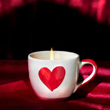 Romantic candle light in love cup. For special valentine day Royalty Free Stock Photography