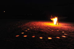 Romantic candle-lit heart and bonfire on a private Maldivian island Royalty Free Stock Photo
