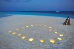 Romantic candle-lit heart on a private island. As the blood moon rise above the horizon in Maldives Stock Photography