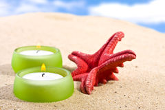 Romantic candle set on the beach Royalty Free Stock Photo