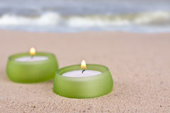 Romantic candle set on the beach Stock Images