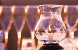 Romantic Candle. With wine glasss in the background Royalty Free Stock Photo