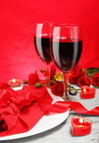 Romantic Candlelight Dinner for Two in Red Stock Photo