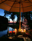 Romantic Candlelit Dinner by the Lake Royalty Free Stock Image