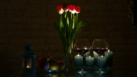 A romantic Candlelit Dinner. In a Warm and Cozy Atmosphere with a Glass of red Wine stock video