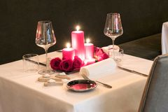 Romantic candlelit table setting for two Stock Photos
