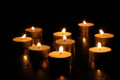 Romantic candles. Romantic hot candle light on black background Royalty Free Stock Image