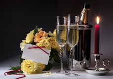 Romantic card with burning candles and champagne Royalty Free Stock Photo