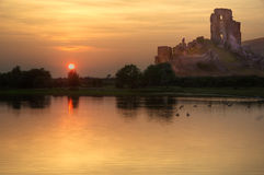 Romantic castle ruins, sunset and lake Royalty Free Stock Photography