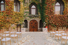 Romantic castlestyle entrance with wedding served yard and floral decoration Royalty Free Stock Images