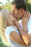 Romantic Caucasian Lover Kissing Outdoor Stock Images