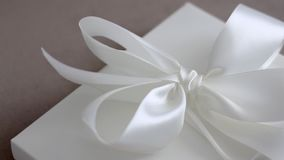 Luxury holiday gift box with white silk ribbon and bow, bridal surprise stock video