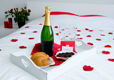 Romantic champagne breakfast. In bed Stock Photos