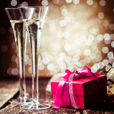 Romantic champagne with a red gift Royalty Free Stock Images