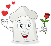Romantic Chef Hat Holding a Red Rose Stock Photo