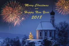 Romantic christmas chapel with xmas tree and fireworks Stock Image