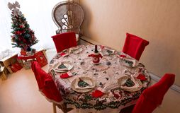 A romantic Christmas dinner table setting with Christmas decorations.