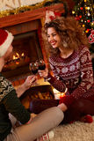 Romantic Christmas evening with glasses of red wine Stock Photography
