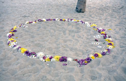 Romantic circle of flowers at the beach Royalty Free Stock Images