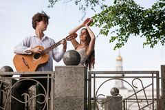 Romantic city date couple guitar music concept. Dancing in the street. Happy together Royalty Free Stock Photography