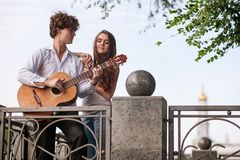Romantic city date couple guitar music concept. Serenade for beloved. Happy together Stock Images