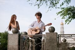 Romantic city date couple guitar music concept. Serenade for beloved. Happy together Royalty Free Stock Images