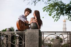 Romantic city date couple guitar music concept. Serenade for beloved. Happy together Royalty Free Stock Image