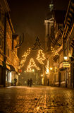 Romantic city at Night at Christmas with couple. A couple walking a Street lit with Christmas lighting in a picturesque half timbered town in Germany Stock Images