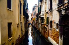 Small tight canal at romantic city of Venice stock photo