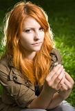 Romantic closeup portrait of a young redhead. Royalty Free Stock Photography