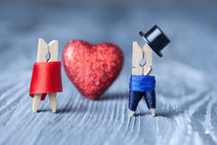 Romantic clothespins. Valentines day. Man, woman. Clothespins. Gentleman in black hat and woman in red dress. Stock Images