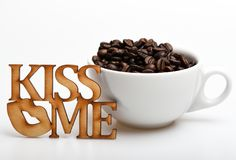Romantic coffee break. Mug coffee beans on white background. Enjoy coffee drink. Date in cafe concept. Beverage consist. Caffeine. Ceramic cup with coffee beans stock image
